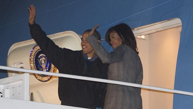 US President Barack Obama and First Lady Michelle Obama board Air Force One on January 24, 2015 as they depart from Andrews Air Force Base in Maryland for a three-day trip to India