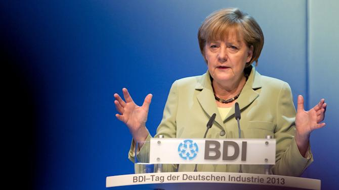 Germany's Merkel defends costly election pledges