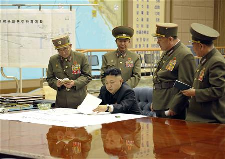 North Korean leader Kim Jong-un (C) presides over an urgent operation meeting on the Korean People's Army Strategic Rocket Force's performance of duty for firepower strike at the Supreme Command in Pyongyang, early March 29, 2013, in this picture released by the North's official KCNA news agency on Friday. REUTERS/KCNA