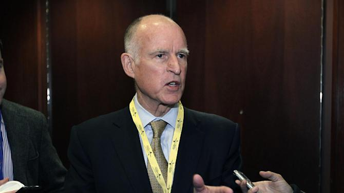 California Gov. Jerry Brown speaks with reporters during the National Governors Association winter meeting in Washington, on Sunday, Feb. 26, 2012. ( AP Photo/Jose Luis Magana)