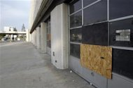 A boarded-up storefront on Fourth Street in San Bernardino July 11, 2012. The city council of San Bernardino, California, voted on Tuesday to file for bankruptcy, marking the third time in recent weeks a city in the most populous U.S. state has opted to seek protection from its creditors. Picture taken July 11, 2012. REUTERS/Alex Gallardo