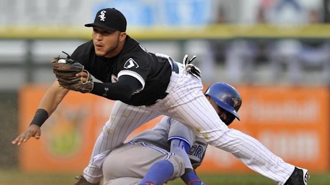 Chicago White Sox second baseman Carlos Sanchez (5), catches the throw while Toronto Blue Jays' Jose Reyes (7), steals second base during the first inning of a baseball game Tuesday, July 7, 2015 in Chicago. (AP Photo/Paul Beaty)