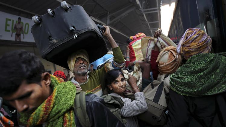 Indians crowd on a train on platform six near where a stampede took pace a night before, at a station in Allahabad, India, Monday, Feb. 11, 2013. The death toll from a stampede in a train station rose to 37 on Monday in the northern India city where millions of devotees had gathered for a Hindu festival that is one of the world's largest religious gatherings. (AP Photo/Kevin Frayer)