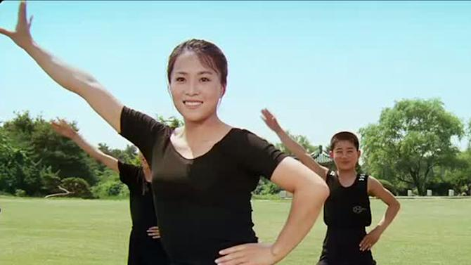 """In this image made out of film """"Comrade Kim Goes Flying"""" released by Another Dimension of An Idea/Koryo Group, Comrade Kim Yong Mi played by Han Jong Sim exercises with younger members of a circus troupe.  It's a classic tale of a small town girl who follows her dreams to the big city. But in this case, the girl is a North Korean coal miner, the big city is Pyongyang and her dream is to become a high-flying trapeze artist. """"Comrade Kim Goes Flying,"""" a collaboration between a North Korean director and two European filmmakers, makes its world premiere Saturday, Sept. 8, 2012 at the Toronto International Film Festival before it heads to Pyongyang later this month for its North Korean debut. (AP Photo/Courtesy of Another Dimension of An Idea/Koryo Group) EDITORIAL USE ONLY"""