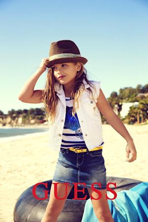This campaign ad image provided by Guess? Inc., shows 6-year-old Dannielynn Birkhead. Birkhead, the daughter of the late Anna Nicole Smith, is walking in her mother's shoes, taking a starring role in the spring ad campaign for Guess Kids. (AP Photo/Guess? Inc.)