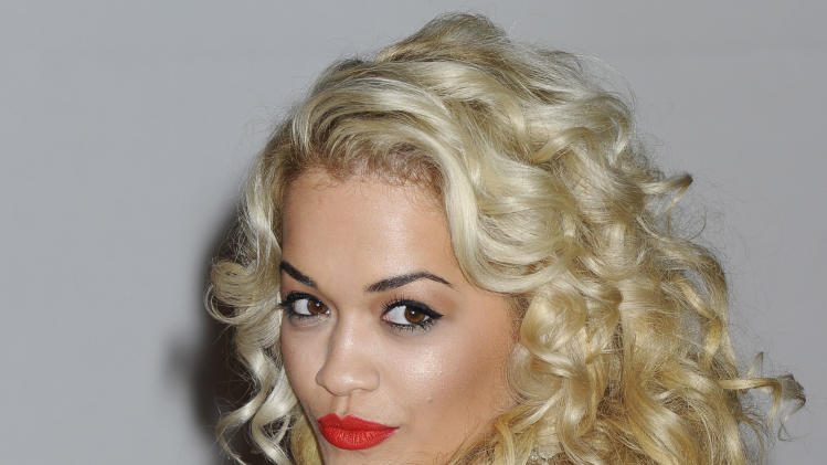 FILE - In this Feb. 21, 2012 file photo, performer Rita Ora arrives for the Brit Awards 2012 at the O2 Arena in London. Jay-Z's protege Rita Ora said Tuesday, May 8, 2012 she's not dating Drake, they're just good friends. (AP Photo/Jonathan Short, File)