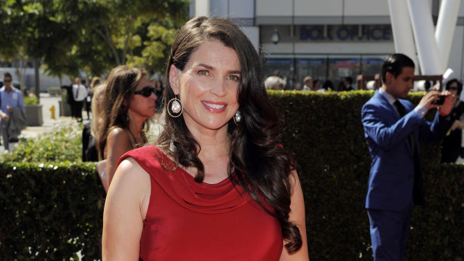 """FILE - In this Sat., Sept. 15, 2012 file photo, Julia Ormond arrives at the 2012 Creative Arts Emmys at the Nokia Theatre, in Los Angeles. Television looks like the land of female opportunity with the success of shows like """"Girls"""" and """"New Girl"""" and the achievements of actor-writers including Tina Fey and Lena Dunham. but making TV remains largely man's work. (Photo by Chris Pizzello/Invision/AP, File)"""