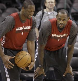 Miami Heat guard Dwyane Wade, left, and forward LeBron James talk during practice, Monday, June 11, 2012, in Oklahoma City. Game 1 of  NBA basketball finals between the Heat and Oklahoma City Thunder is scheduled for Tuesday. (AP Photo/Sue Ogrocki)