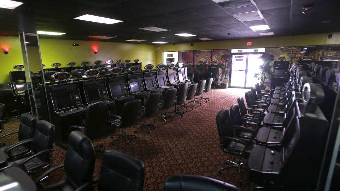 """Turned off gambling machines are shown at the Tropicana Bingo and Arcade in Hialeah, Fla., Thursday, April 10, 2013. Gaming centers also known as """"Internet cafes"""" are now illegal in Florida. Gov. Rick Scott signed a bill Wednesday that bans up to 1,000 storefront operations across the state. The new law took effect immediately after Scott signed the bill.(AP Photo/Alan Diaz)"""