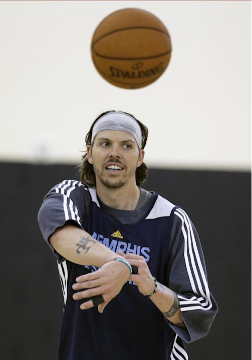Memphis Grizzlies' Mike Miller passes the ball during NBA basketball training camp Tuesday, Oct. 1, 2013, in Nashville, Tenn. The Grizzlies are scheduled to hold training camp in Nashville through Sat