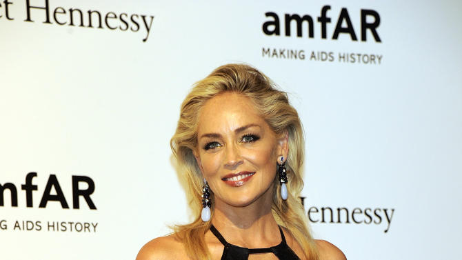 USA  Actress Sharon Stone poses at the Amfar charity event, part of the Fashion Week in Milan, Italy, Saturday, Sept.22, 2012. (AP Photo/Giuseppe Aresu)