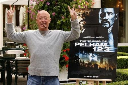 "Director Tony Scott poses during a photocall to promote his lastest film ""The Taking of Pelham 123"" in Paris July 20, 2009. REUTERS/Benoit Tessier"