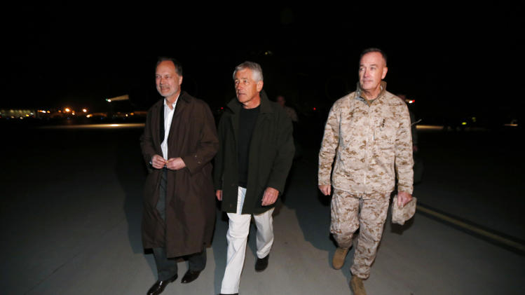 U.S. Secretary of Defense Chuck Hagel walks with U.S. Ambassador to Afghanistan James Cunningham, left, and Gen. Joseph Dunford, Commander of the International Security Force, upon Hagel's arrival in Kabul, Afghanistan, Friday, March 8, 2013. This is Hagel's first official trip since being sworn-in as Obama's Defense Secretary. (AP Photo/Jason Reed, Pool)