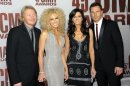 """FILE - In a Nov. 9, 2011 file photo, from left, Phillip Sweet, Kimberly Schlapman, Karen Fairchild and Jimi Westbrook of Little Big Town arrive at the 45th Annual CMA Awards in Nashville. Little Big Town co-wrote and recorded the theme song for ABC's new show """"Good Afternoon America."""" (AP Photo/Evan Agostini, file)"""