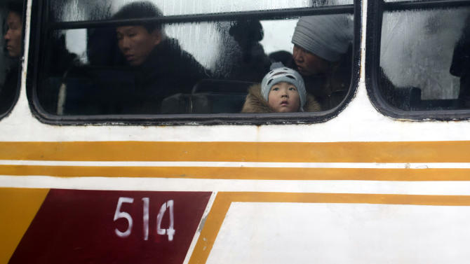 A North Korean child looks out from a bus on the eve of the first anniversary of the death of late North Korean leader Kim Jong Il in Pyongyang, North Korea, Sunday, Dec. 16, 2012. (AP Photo/Ng Han Guan)
