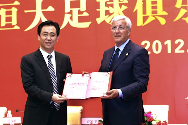 World Cup-winning Coach Marcello Lippi (R) And Guangzhou Evergrande's Chairman Xu Jiayin (L) Attend A Signing Ceremony AFP/Getty Images