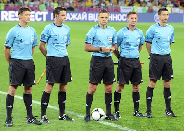 Slovenian Referee Damir Skomina (C) And His AFP/Getty Images