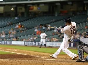 Pena's homer in 10th lifts Astros over Brewers