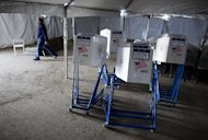 Voting machines rest under a tent that has become a make shift voting locations at PS 180 in the Rockaway neighborhood of the borough of Queens York, Monday, Nov. 5, 2012, in the wake of Superstorm Sandy. Election officials are ordering generators, moving voting locations and figuring out how to transport poll workers displaced from coastal areas as Tuesday&#39;s presidential election became the latest challenge for states whacked by Superstorm Sandy. The storm, which devastated East Coast communities with power outages, flooding and snow, had already disrupted early voting in parts of Maryland, West Virginia, New Jersey and North Carolina. (AP Photo/Craig Ruttle)