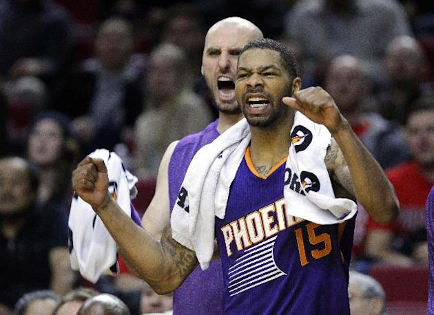 The Phoenix Suns'  Marcus Morris, right, and Marcin Gortat cheer from the bench during the second half of an NBA preseason basketball game against the Portland Trail Blazers in Portland, Ore., Wednesd