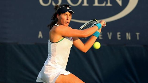 Johanna Konta of Great Britain returns a shot during her match against Olga Govortsova of Belarus at the US Open (AFP)