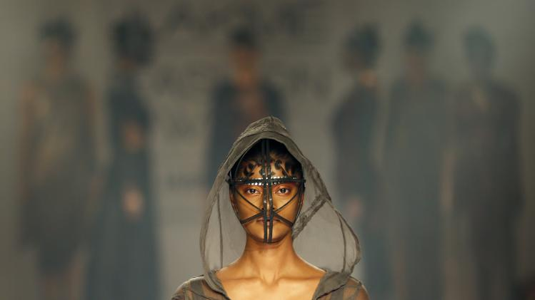A model displays a creation by a Gen Next designer during the first day of the Lakme Fashion Week in Mumbai, India, Wednesday, Aug. 20, 2014. (AP Photo/Rajanish Kakade)