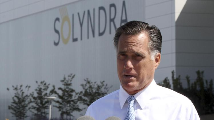 "FILE - In this May 31, 2012 file photo, Republican presidential candidate, former Massachusetts Gov. Mitt Romney speaks outside the Solyndra manufacturing facility, in Fremont, Calif. Romney says Friday's jobs report is ""devastating news"" for American workers and families. (AP Photo/Mary Altaffer, File)"