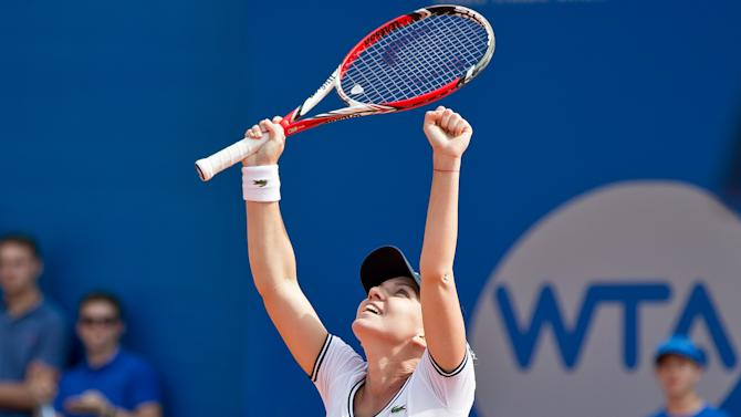 Halep beats Petkovic for 1st career title