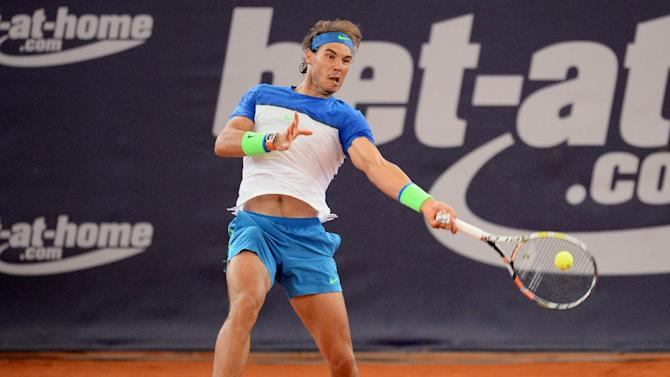 Spain's Rafael Nadal returns the ball during his round of sixteen match against Czech Republic's Jiri Vesely at the ATP tournament in Hamburg, northern Germany on July 30, 2015