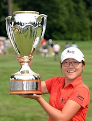 Lydia Ko with the trophy after winning the Canadian Women's Open at The Vancouver Golf Club on Sunday. South Korea-born Ko's victory was the result of years of dawn-to-dusk practising and a love of golf which started when she was five