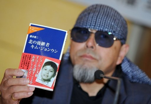 <p>Kenji Fujimoto, former sushi chef to North Korean leader Kim Jong-Il, holds up his book showing a picture of Kim Jong-Un during a press conference in Seoul. Fujimoto, who served Kim Jong-Il for 13 years, was seen on his way to revisit the country on Friday.</p>
