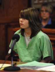 "FILE - In this Dec. 8, 2009 file photo, Alyssa Bustamante, 15, listens during a brief hearing where her attorney entered not guilty pleas on her behalf to charges of armed criminal action and first-degree murder in Cole County Circuit Court in Jefferson City, Mo. Bustamante, who admitted stabbing, strangling and slitting the throat of a young neighbor girl, wrote in her journal on the night of the killing that it was an ""ahmazing"" and ""pretty enjoyable"" experience — then headed off to church with a laugh. The words written by Bustamante were read aloud in court Monday, Feb. 6, 2012, as part of a sentencing hearing to determine whether she should get life in prison or something less for the October 2009 murder of her neighbor, 9-year-old Elizabeth Olten, in a small town west of Jefferson City. (AP Photo/Kelley McCall, Pool, File)"