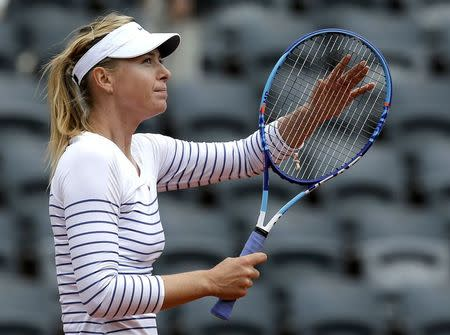 Maria Sharapova of Russia celebrates after beating compatriot Vitalia Diatchenko during their women's singles match at the French Open tennis tournament at the Roland Garros stadium in Paris