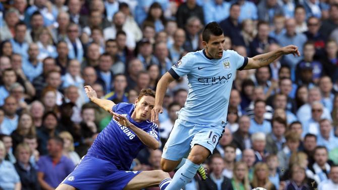 Chelsea's Matic challenges Manchester City's Aguero during their English Premier League soccer match at the Etihad stadium in Manchester