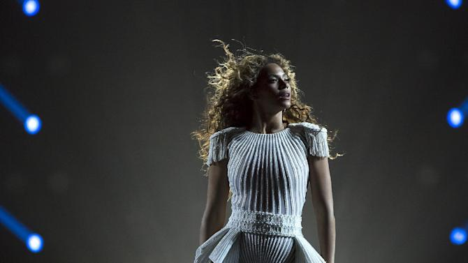 """IMAGE DISTRIBUTED FOR PARKWOOD ENTERTAINMENT - Singer Beyonce performs on her """"Mrs. Carter Show World Tour 2013"""" at the Ziggo Dome on Monday, April 22, 2013 in Amsterdam. Beyonce is wearing a custom hand beaded peplum one-piece by Ralph & Russo with shoes by Stuart Wieztman. (Photo by Yosra El-Essawy/Invision for Parkwood Entertainment/AP Images)"""