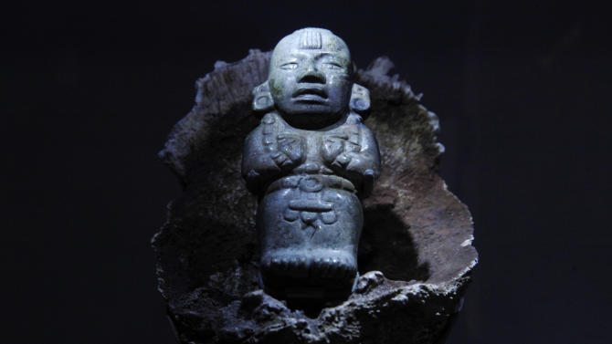A jade figurine of Maize God is shown at the Maya 2012: Lords of Time exhibit at the University of Pennsylvania Museum of Archaeology and Anthropology Thursday, May 3, 2012, in Philadelphia. The exhibit is scheduled to open May 5. (AP Photo/Matt Rourke)