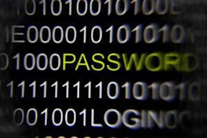 A magnifying glass is held in front of the word 'password'…