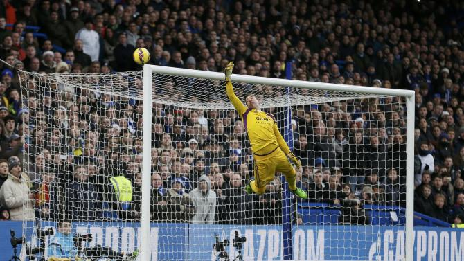 West Ham United's goalkeeper Adrian dives for a shot during thier English Premier League soccer match against Chelsea at Stamford Bridge in London