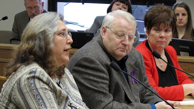 Judy Cox, mother of missing Utah mother Susan Powell, testifies before a Senate committee as her husband, Chuck, center, and Sen. Pam Roach, right, listen on Friday, Feb. 1, 2013, in Olympia, Wash. Roach has sponsored a bill to restrict or block visitation rights for someone who is the subject of a murder investigation. The Cox's son-in-law, Josh Powell, long scrutinized by authorities for the disappearance of his wife, killed himself and his two young children last year. (AP Photo/Rachel La Corte)