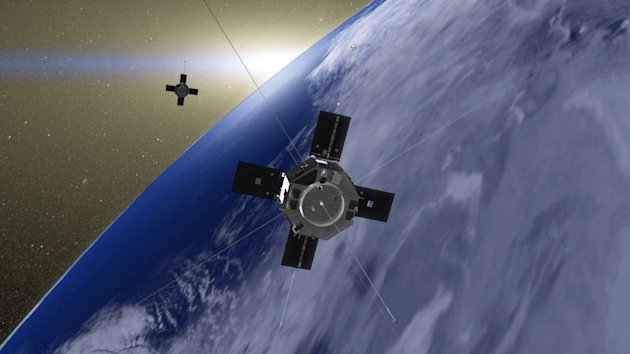 This undated image made available by NASA and the Goddard Space Flight Center shows an artist's rendition of the Van Allen Probes in orbit around Earth. The twin spacecraft have captured the clearest sounds yet from Earth's radiation belts - and they mimic the chirping of birds. NASA's Van Allen Probes have been exploring the hostile radiation belts surrounding Earth for just three months. But already, they've collected measurements of high-energy particles and radio waves in unprecedented detail. Scientists said Tuesday, Dec. 4, 2012 these waves can provide an energy boost to radiation belt particles, somewhat like ocean waves can propel a surfer on Earth. (AP Photo/NASA/Goddard Space Flight Center)