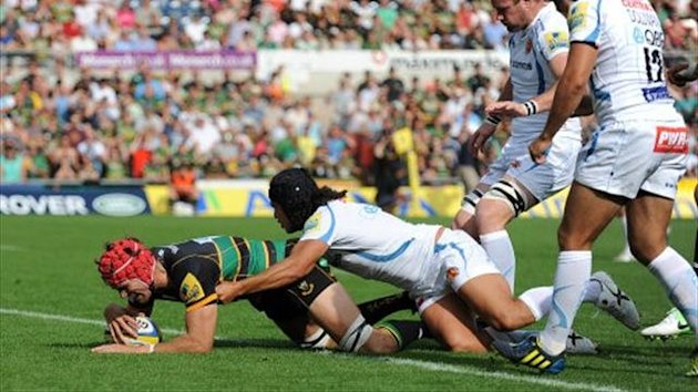 Northampton Saint's Christian Day (red cap) scores his side's first try against the Exeter Chiefs (PA)