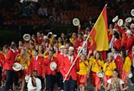 Spain's flagbearer Pau Gasol (C) leads his delegation during the opening ceremony of the London 2012 Olympic Games on July 27, 2012 at the Olympic Stadium in London.     AFP PHOTO / GABRIEL BOUYS