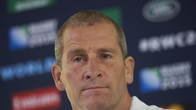 England's head coach Stuart Lancaster attends a press conference at Pennyhill Park hotel near Bagshot, south west of London, on October 4, 2015, a day after England lost their Rugby World Cup 2015 Pool A match against Australia