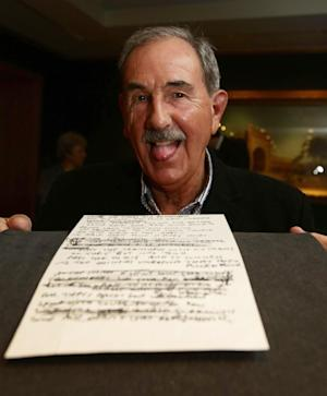"Hunter Davies, Beatles biographer with a manuscript of the lyrics to ""In My Life"", during a photocall to announce a major Beatles acquisition for the British Library at the British Library in London Wednesday May 22, 2013. The august British Library has added substantially to its already formidable collection with handwritten lyrics to ""Strawberry Fields Forever"", ""She Said She Said"" and ""In My Life.""  The manuscripts and a number of Lennon's letters were donated to the library Wednesday by Hunter Davies.   (AP Photo/Yui Mok/PA) UNITED KINGDOM OUT"