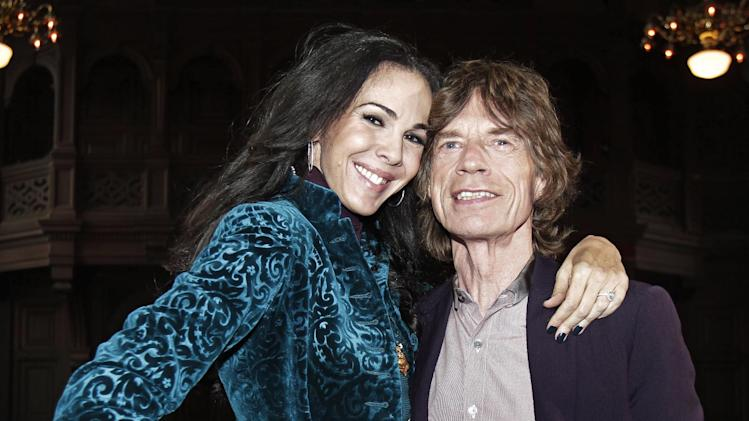FILE - This Feb. 16, 2012 file photo shows singer Mick Jagger, right, with designer L'Wren Scott after her Fall 2012 collection was modeled during Fashion Week, in New York. Scott, a fashion designer, was found dead Monday, March 17, 2014, in Manhattan of a possible suicide. (AP Photo/Richard Drew, File)