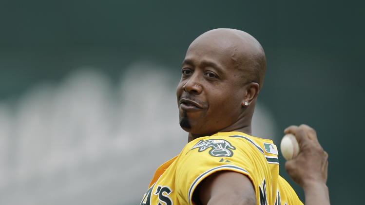 Recording artist M.C. Hammer throws out the ceremonial first pitch prior to the baseball game between the Los Angeles Angels and the Oakland Athletics Sunday, July 17, 2011, in Oakland, Calif. (AP Photo/Ben Margot)