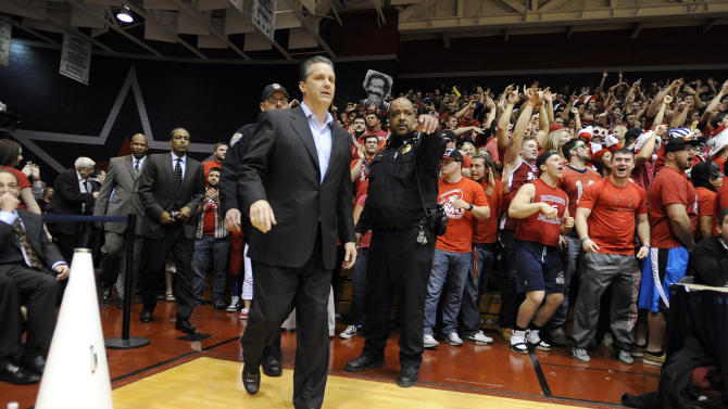 Kentucky head coach John Calipari takes the court before the start of an NIT college basketball game against Robert Morris on Tuesday, March 19, 2013, in Coraopolis, PA. Calipari was a former Robert Morris coach.(AP Photo/Don Wright)