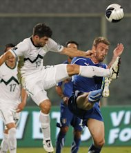 Italy&#39;s midfielder Daniele De Rossi, right, and Slovenia&#39;s midfielder Aleksander Radosavljevic fight for the ball during their group C, EURO 2012 qualifying soccer match, at the Artemio Franchi stadium in Florence, Italy, Tuesday, Sept. 6, 2011. (AP Photo/Fabrizio Giovannozzi)