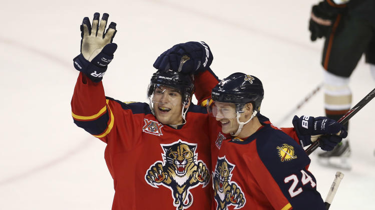 Florida Panthers' Brad Boyes (24) celebrates with Scottie Upshall (19) after Upshall scored against the Anaheim Ducks during the second period of an NHL hockey game in Sunrise, Fla., Tuesday, Nov. 12, 2013. (AP Photo/J Pat Carter)