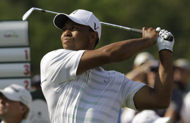 Tiger Woods watches his tee shot on the 15th hole during the first round of the Greenbrier Classic PGA Golf tournament at the Greenbrier in White Sulphur Springs, W. Va., Thursday, July 5, 2012. (AP Photo/Steve Helber)